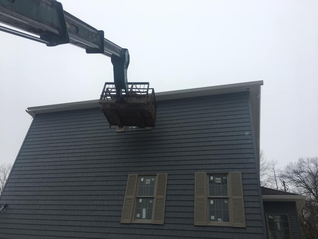Lift to Install Gutters 1
