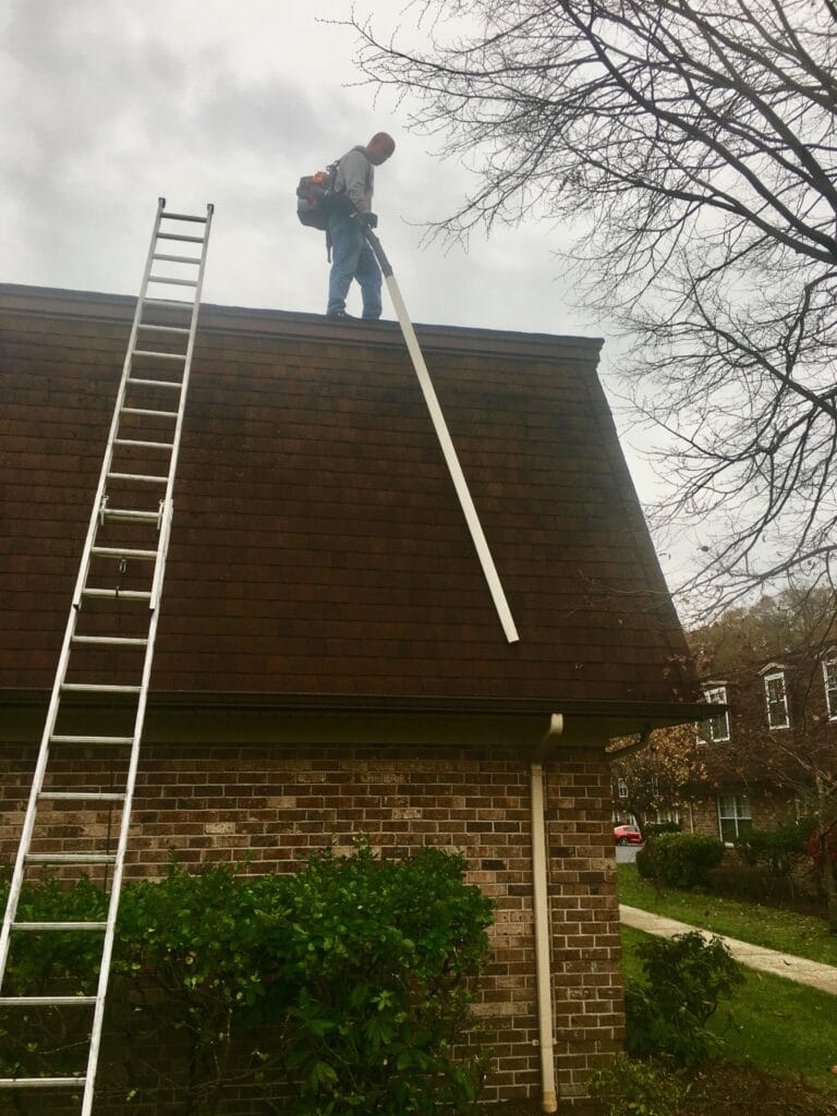 cleaning gutters from top of high roof down