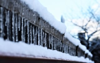 winter gutters with ice and snow