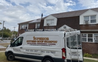 roof cleaning of apartment complex in bergen county nj by superior seamless gutters